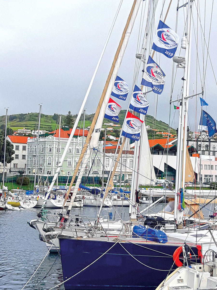 The boats proudly fly their flags at the Horta marina