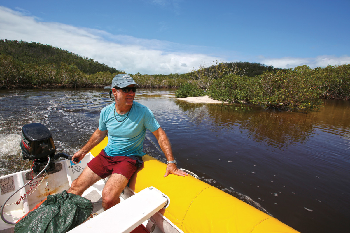 Exploring the mangrove-lined river at Hill Inlet
