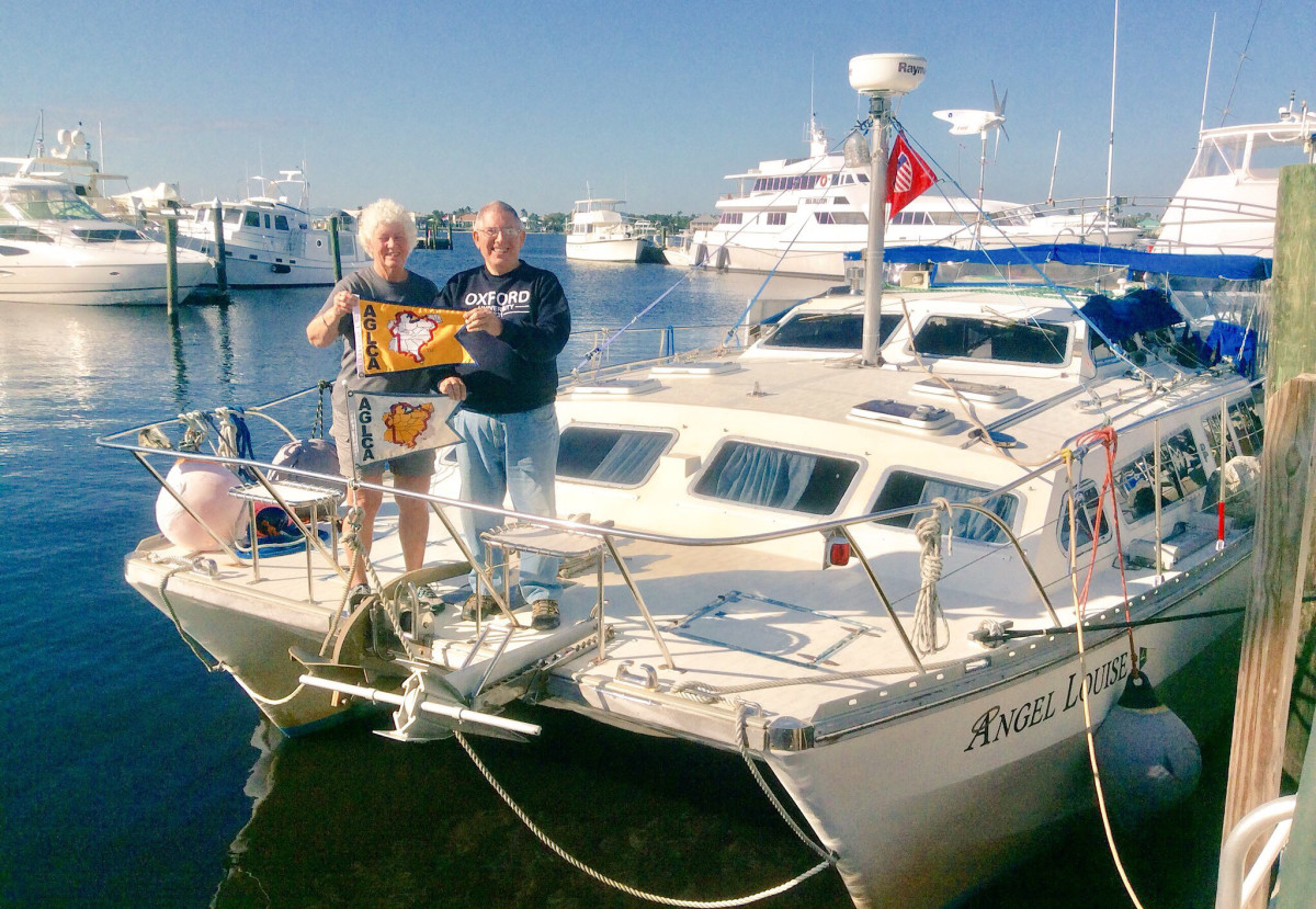 Ed and Sue swap out their standard white Loop Burgee for the gold one signifying a completed passage