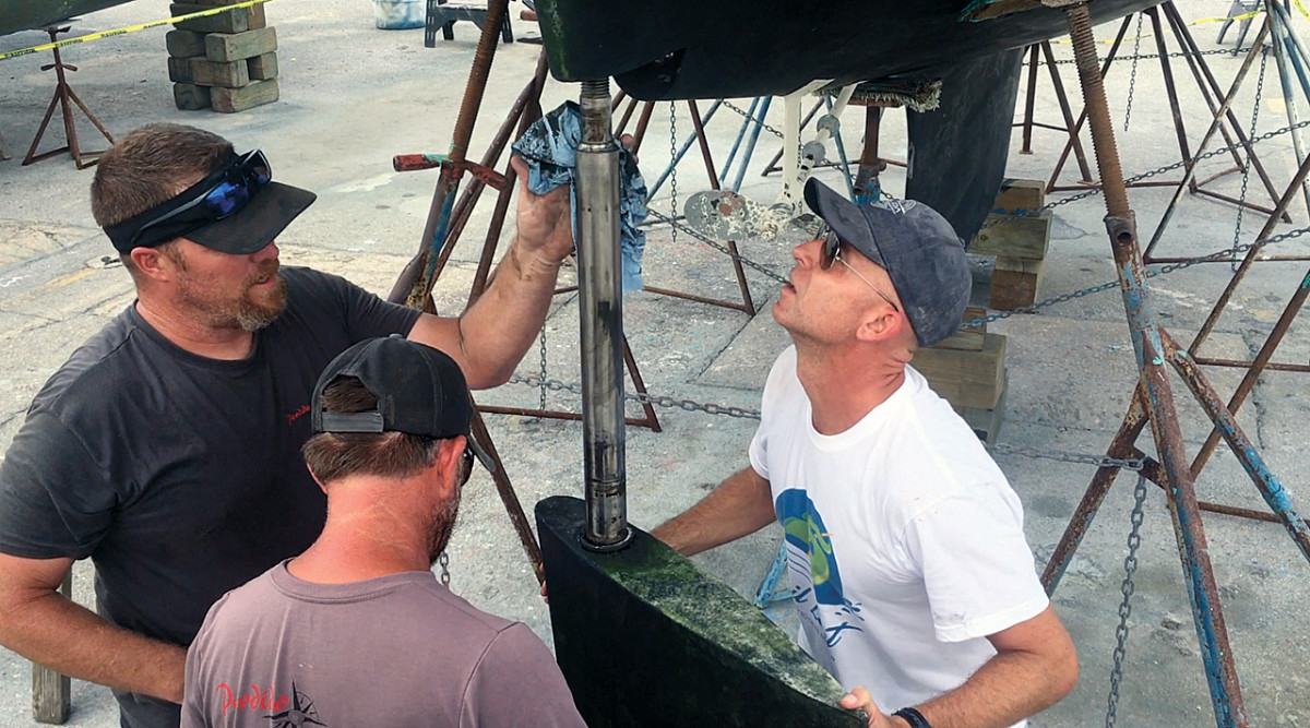 Brandon (left) and Phillip re-install the rudder toward the end of the project