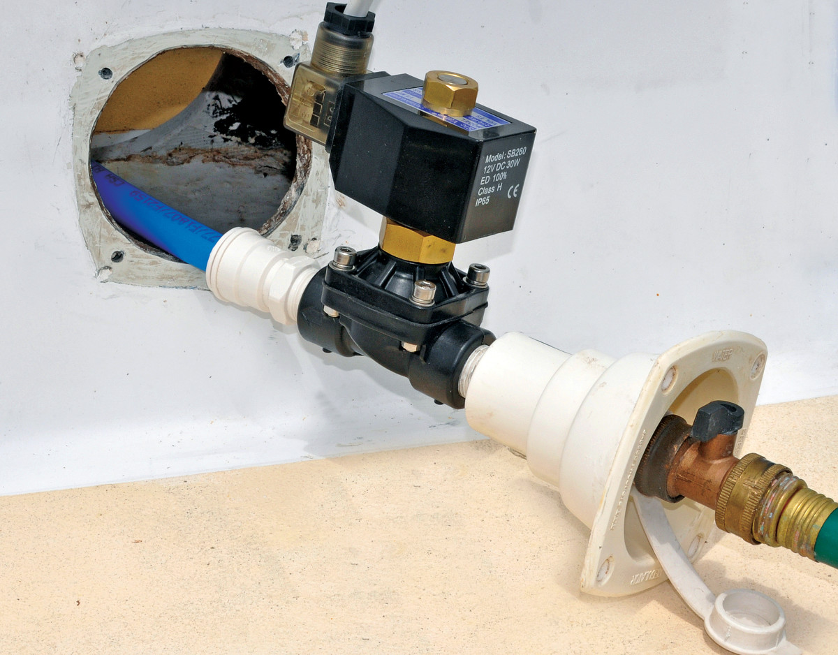 The automatic shut-off valve is the heart of the new protective system. This closes when the bilge float switch is activated by rising water, thereby stopping water entering through the shore water connection