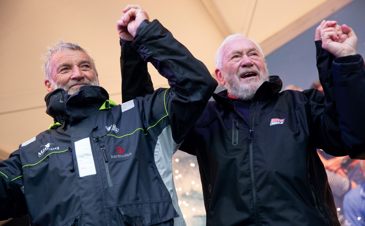 Robin Knox-Johnston (right), winner of the first Golden Globe race 50 years ago, greets Van den Heede at the finish