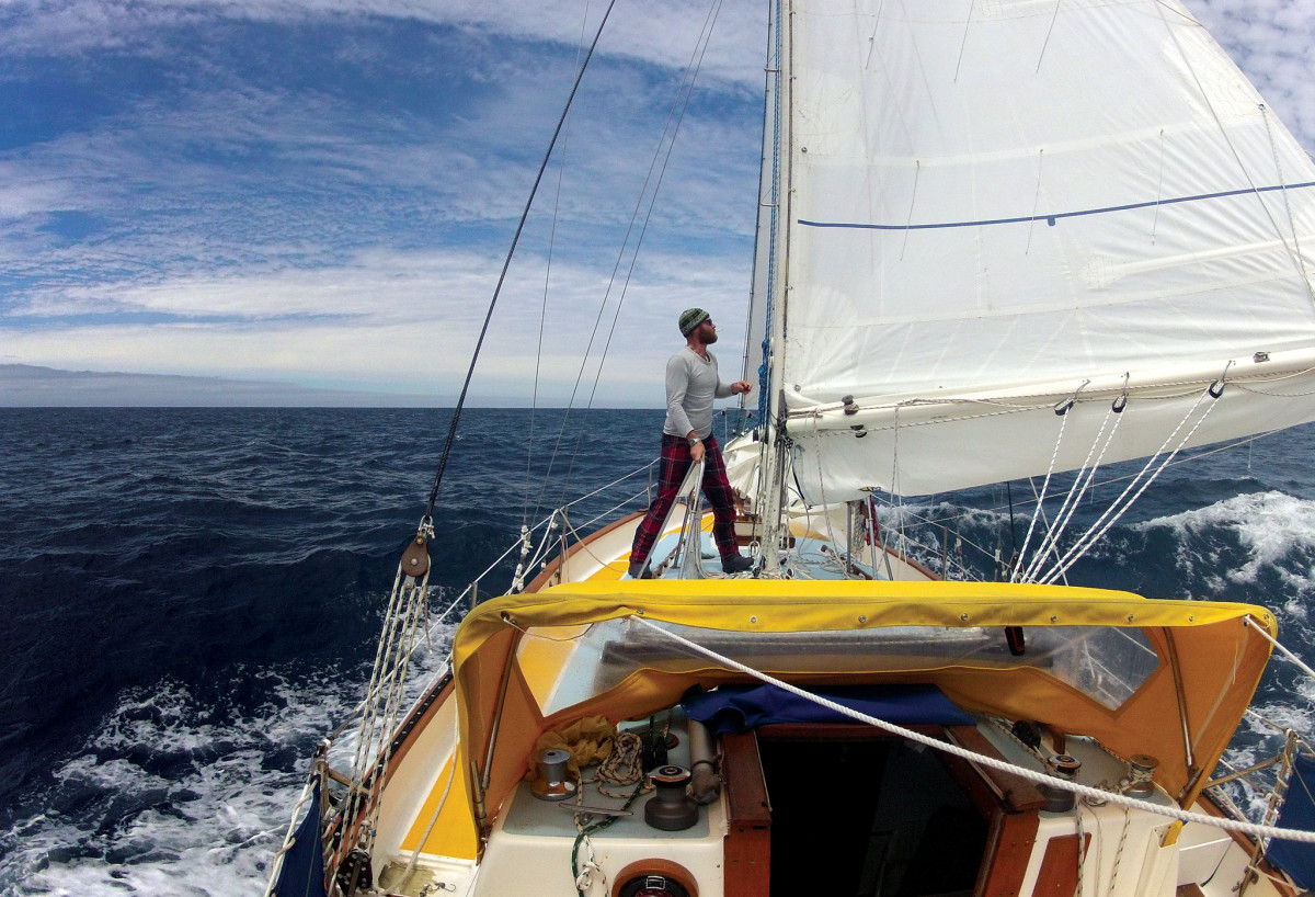 The author tends to the sails on his Westsail 32
