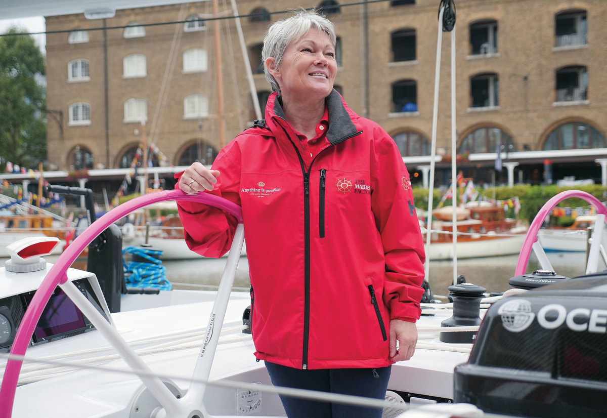 Tracy stands at the helm aboard the newly restored Maiden