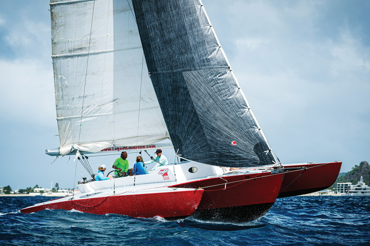 The Dick Newick designed trimaran Tryst wrestles with the wind and waves