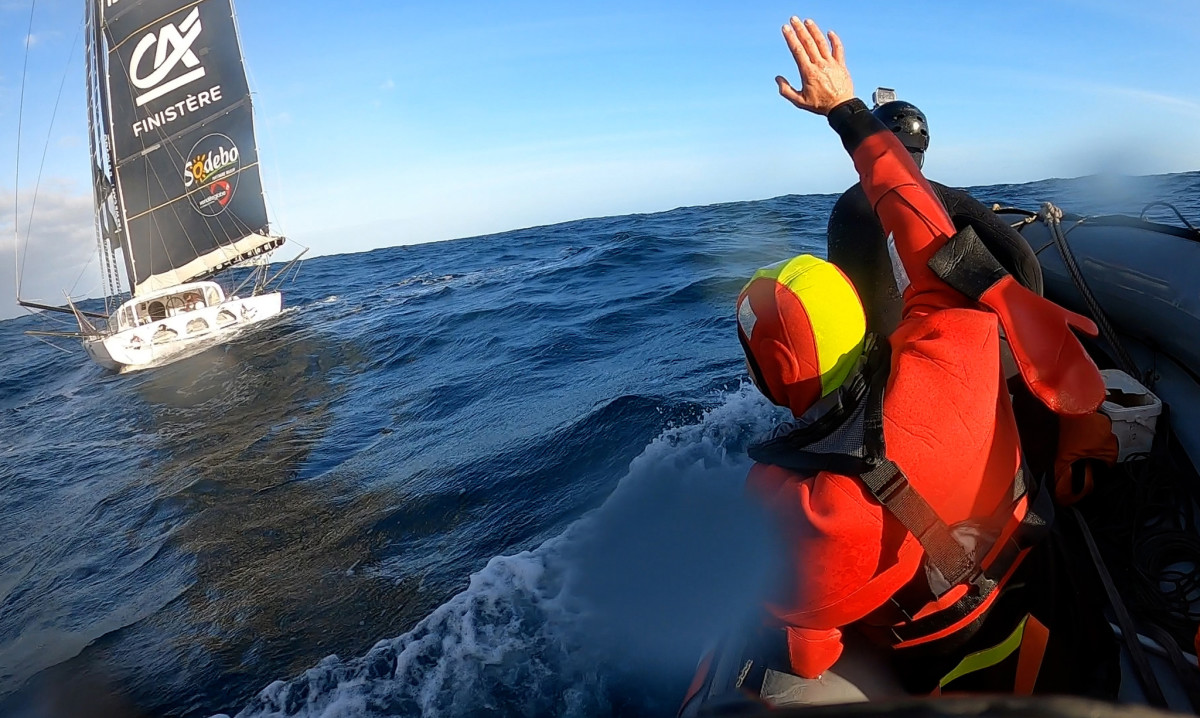 Escoffier waves farewell to Le Cam after being evacuated by the French navy