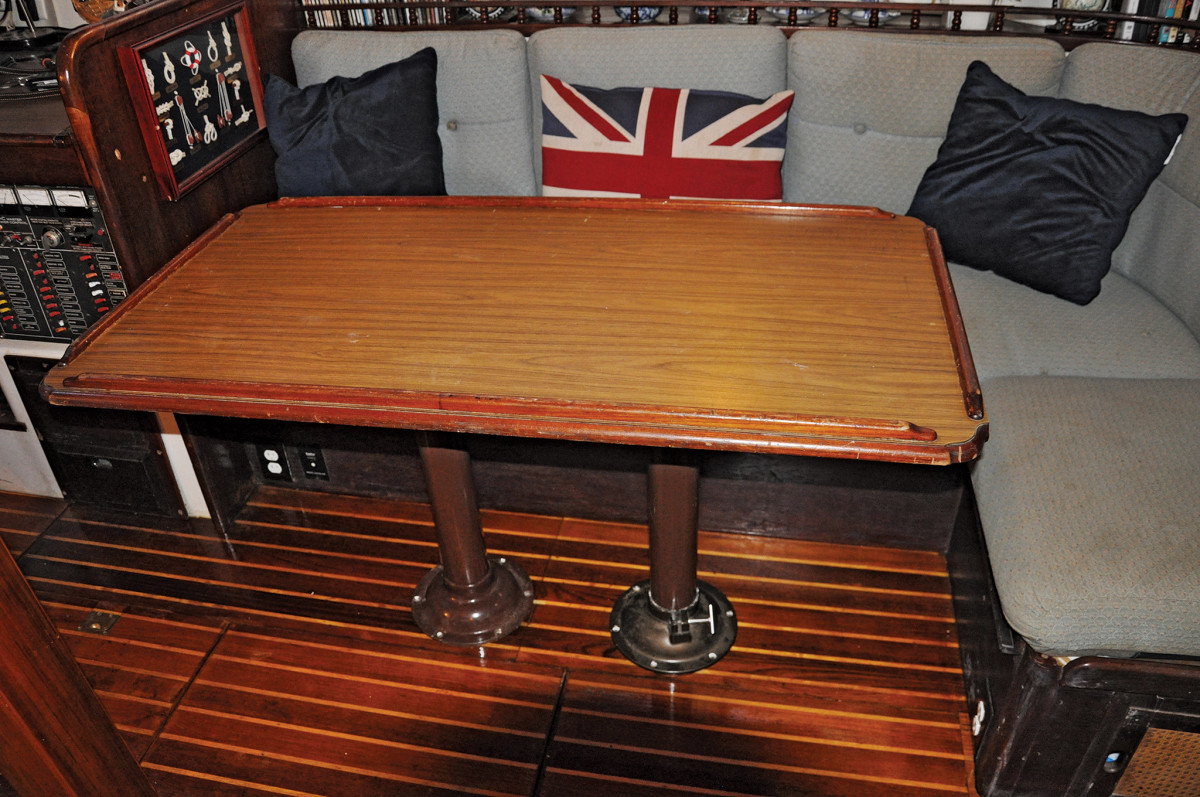 The original saloon table as seen from the starboard-side settee: large but impractical