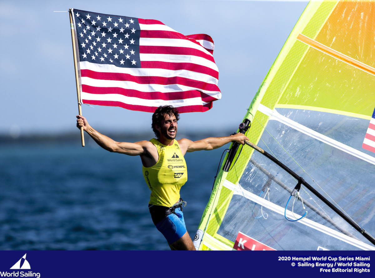 Pedro Pascual celebrates his hard-fought win in the RS:X sailboard men's division
