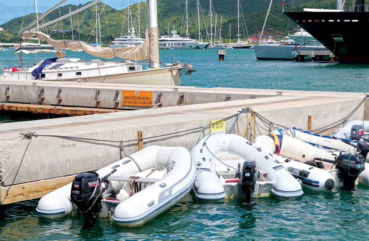 A flotilla of happy, healthy inflatables at a typical dinghy dock