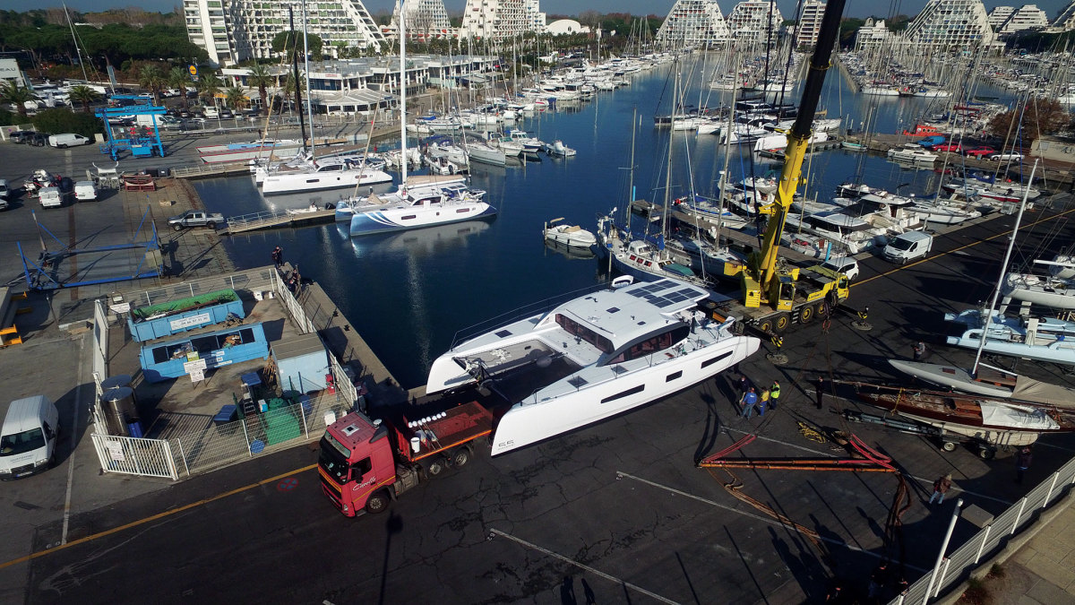 A work crew prepares to splash the new Outremer 55 in France