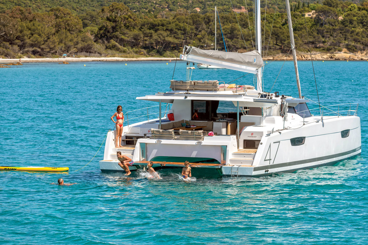 In addition to being fun to sail, this Fountaine Pajot Saona 47 makes for a pretty good diving board!