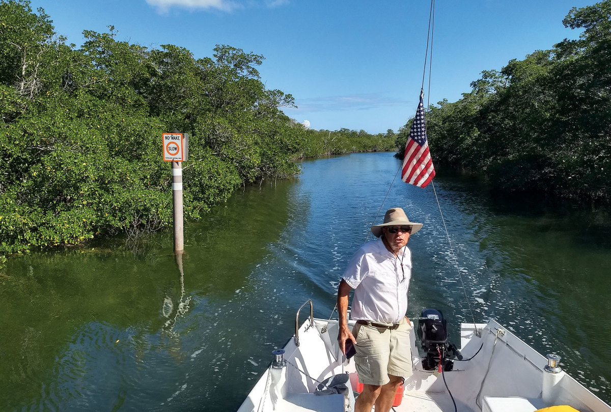 The author at the helm, navigating one of the many narrow channels
