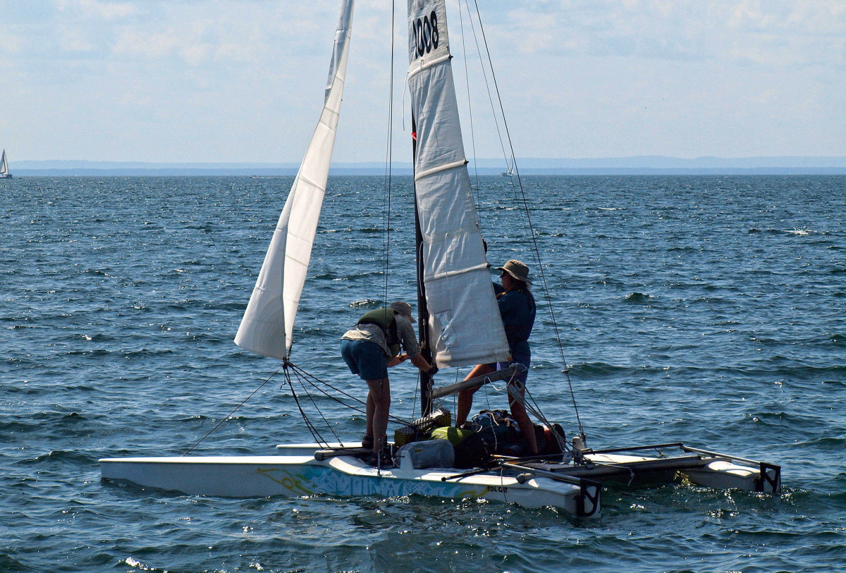 Making sail again after breaking camp ashore
