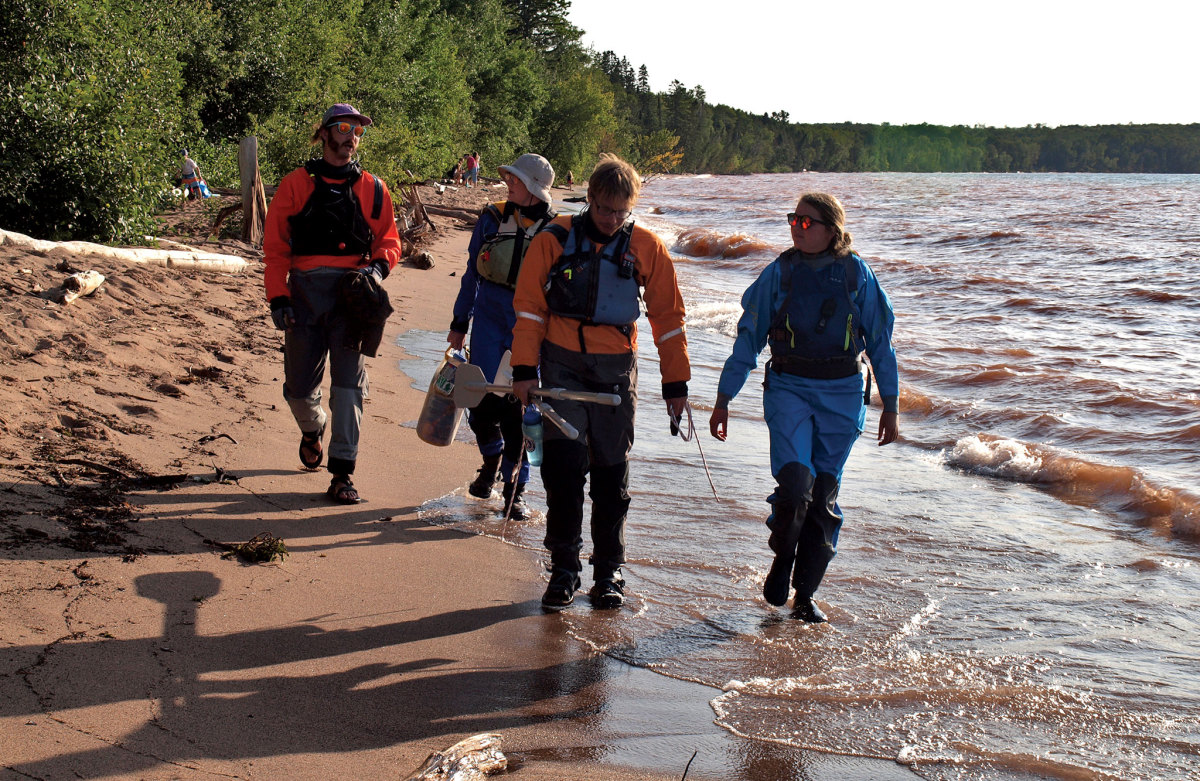 The four expedition members stretch their legs ashore