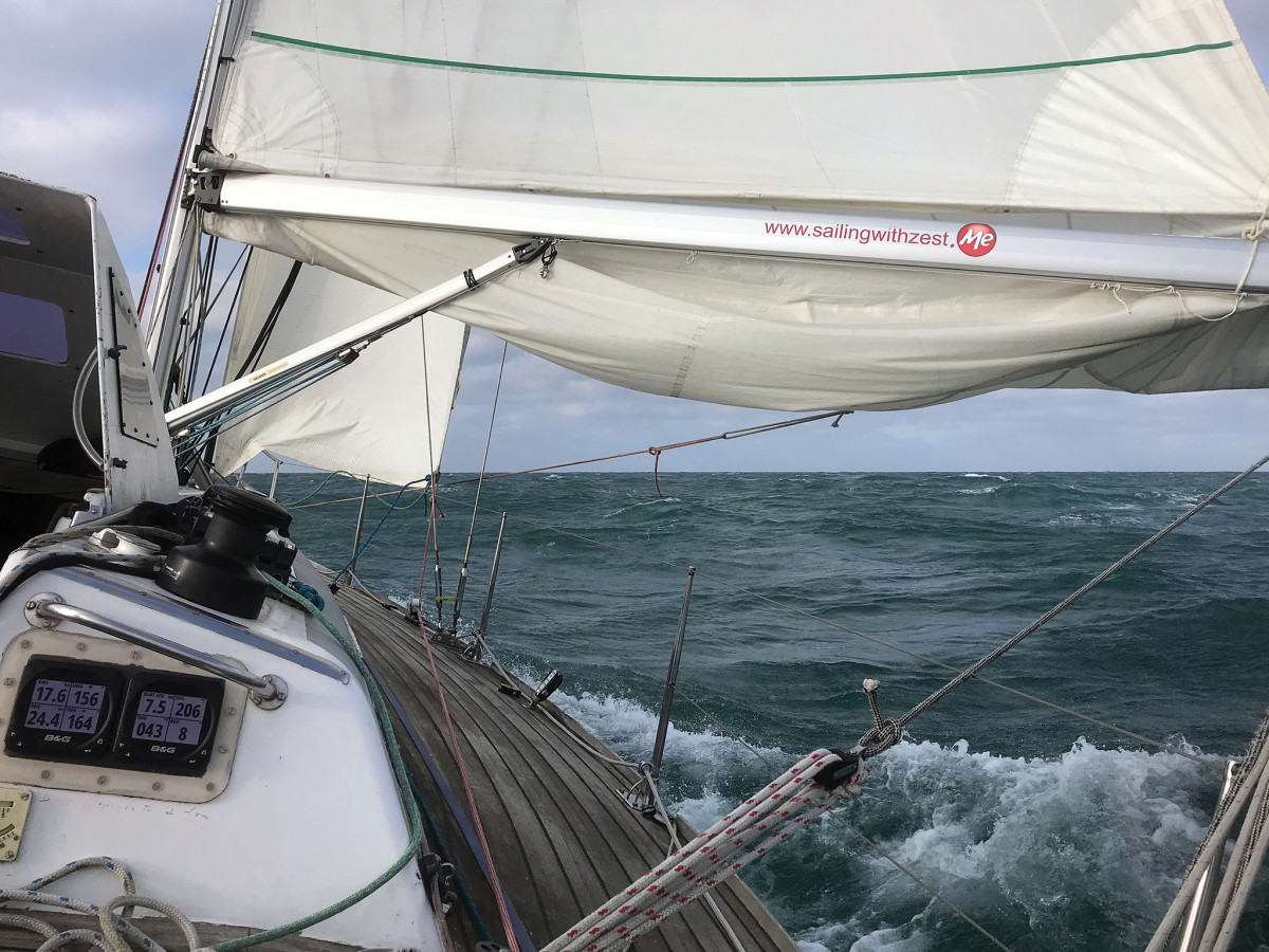 Zest at sea in 20-plus knots of wind with a preventer rigged from the aft end of the boom