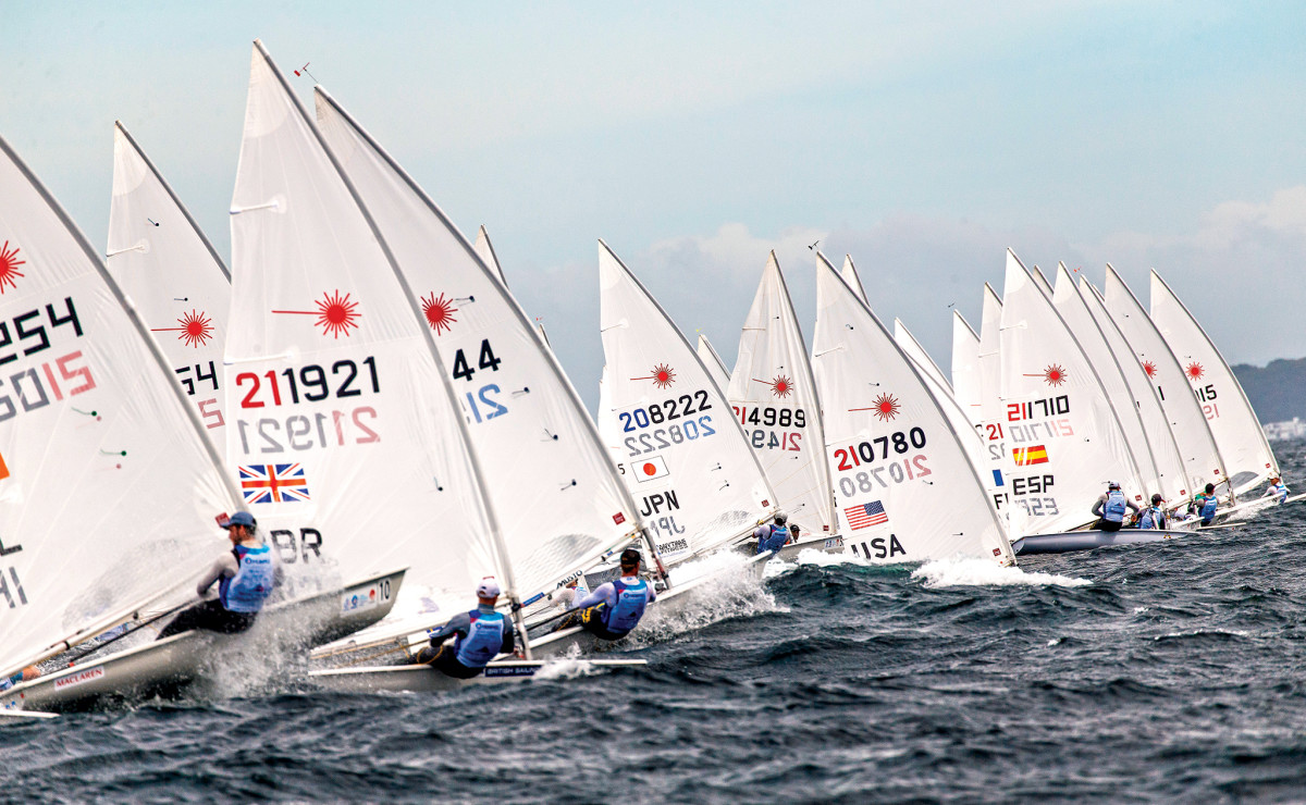 The men's Laser class blasts off the line at the Enoshima portion of the Hempel World Cup