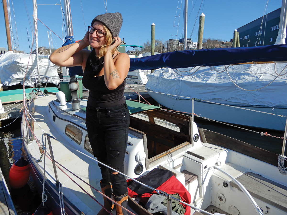 The author's happy client makes a phone call from aboard her new purchase