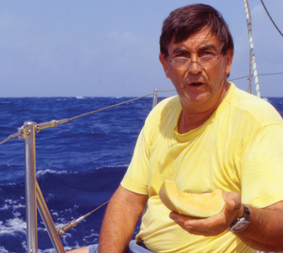 Eric Thiriez in a characteristic pose aboard Alegria, offering food to people