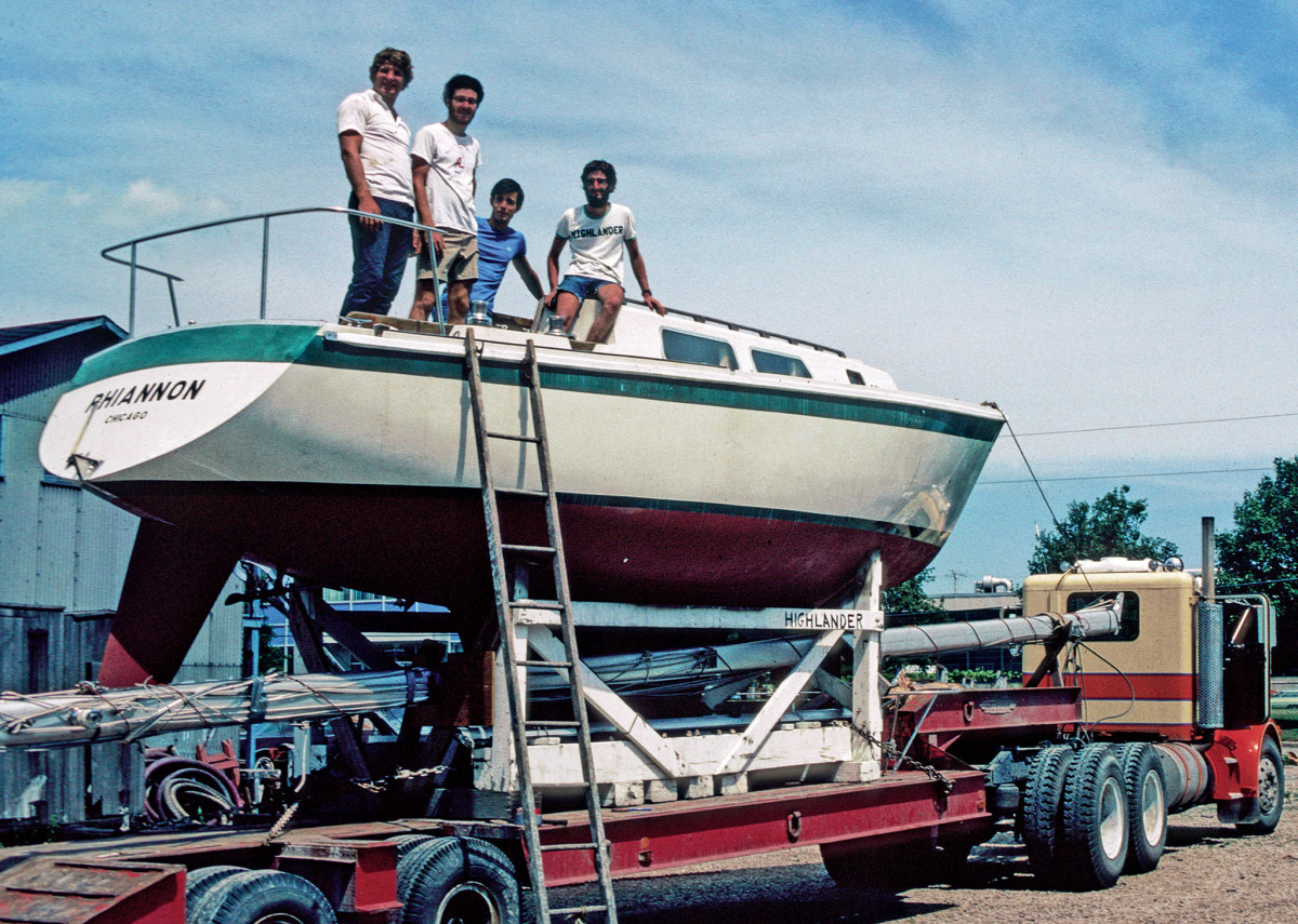"""The """"Louis and Clark"""" crew (from left in the white shirts), Clark Pellett, the author and Louis Gordon, prep their boat for trip down to New Orleans"""