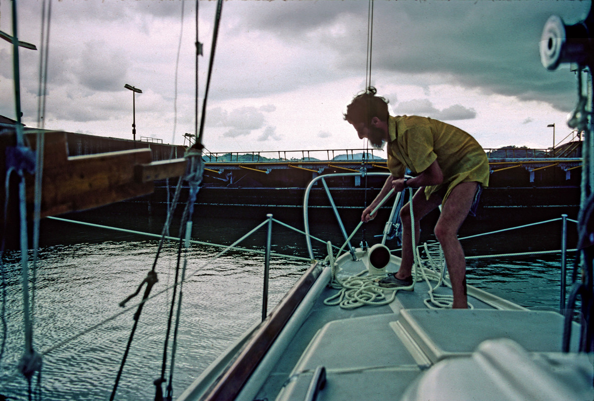 Louis tends to the boat's lines in the Panama Canal