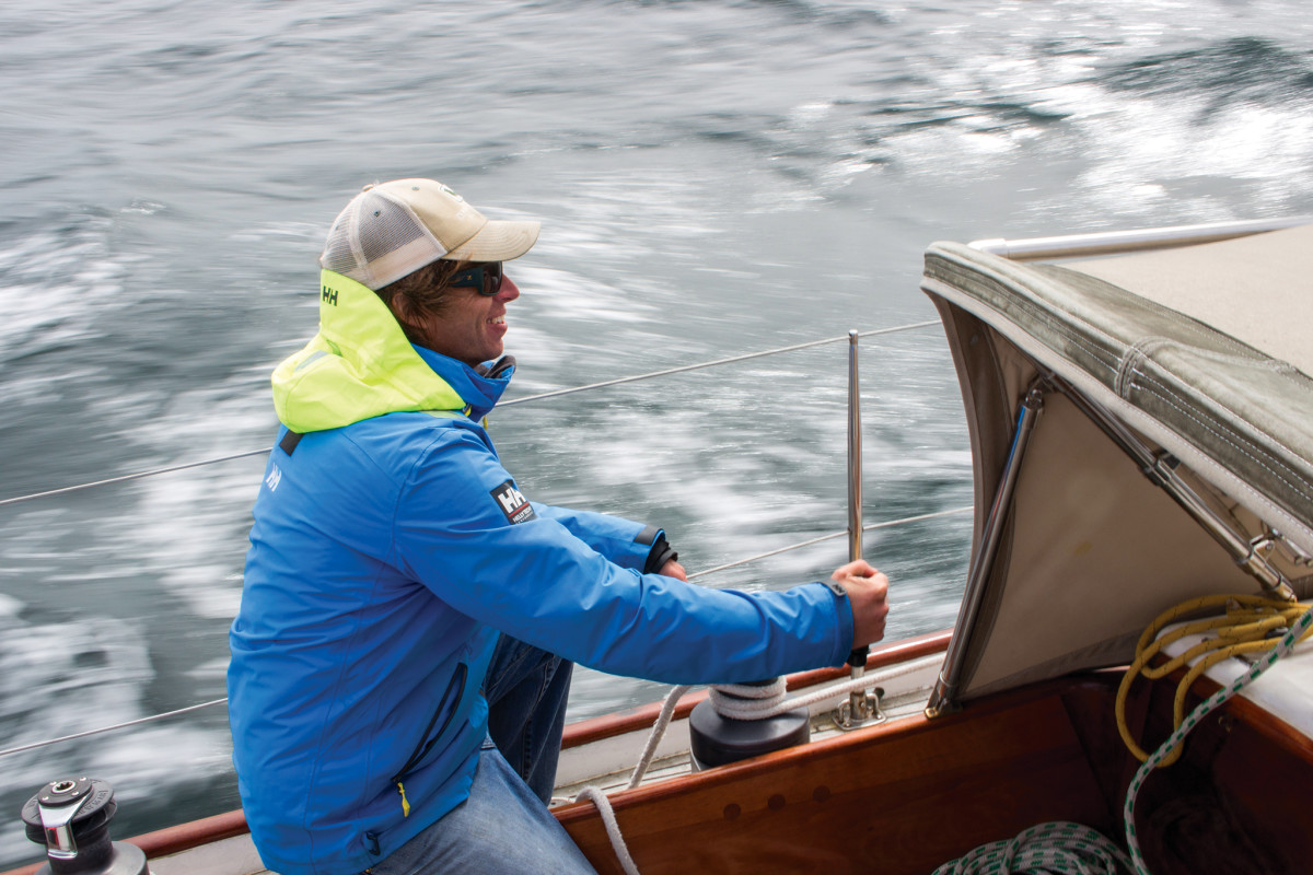 Seth trims the headsail as Celeste continues driving to windward