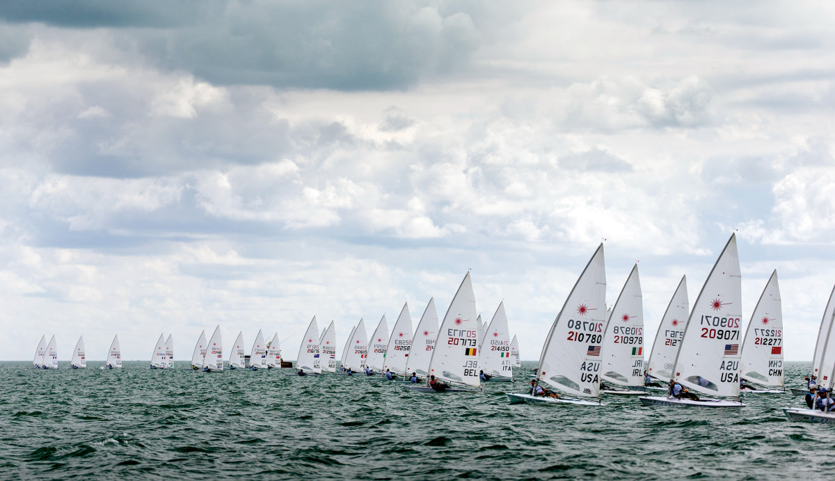 A fleet of Lasers blast off the starting line at the 2019 Hempel World Cup Series